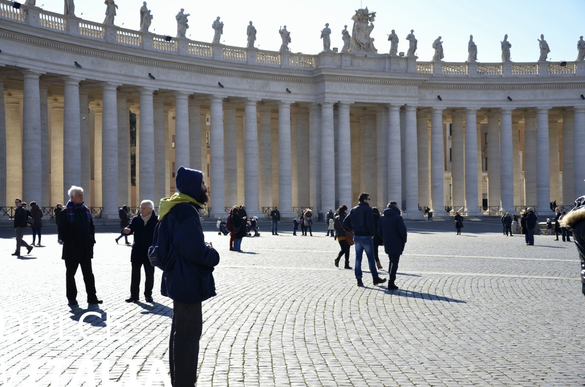 Winter day in ancient Vatican with modern people