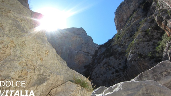 The sun is still visible before it hides behind half a kilometer high walls of Gorropu canyon